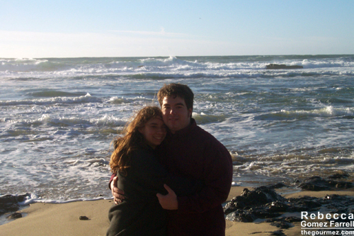 Cuddling at Half Moon Bay on the Pacific because it was cold!