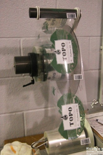 Labeler used for TOPO's bottles. This is the gin label.