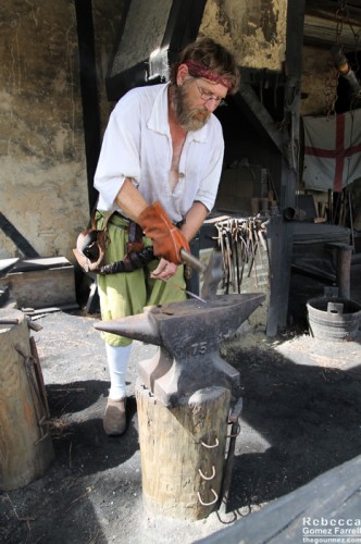 Blacksmith at work in the settlement.