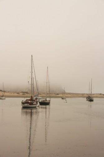 Morro Rock shrouded in fog.