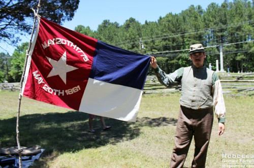 This Confederate soldier showed off the original North Carolina flag in the Confederacy.