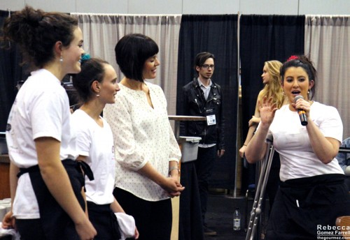 Crystal explaining the concept of CG Pops along with her employees Kali Malham and Kaylan English.