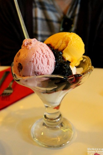 Strawberry, mango, and lemon ice creams with blackberry topping.